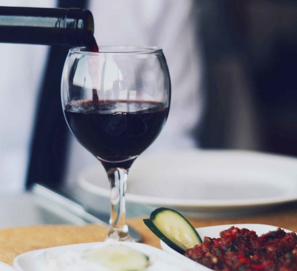 Try less sulfites - pouring red wine in wine glass